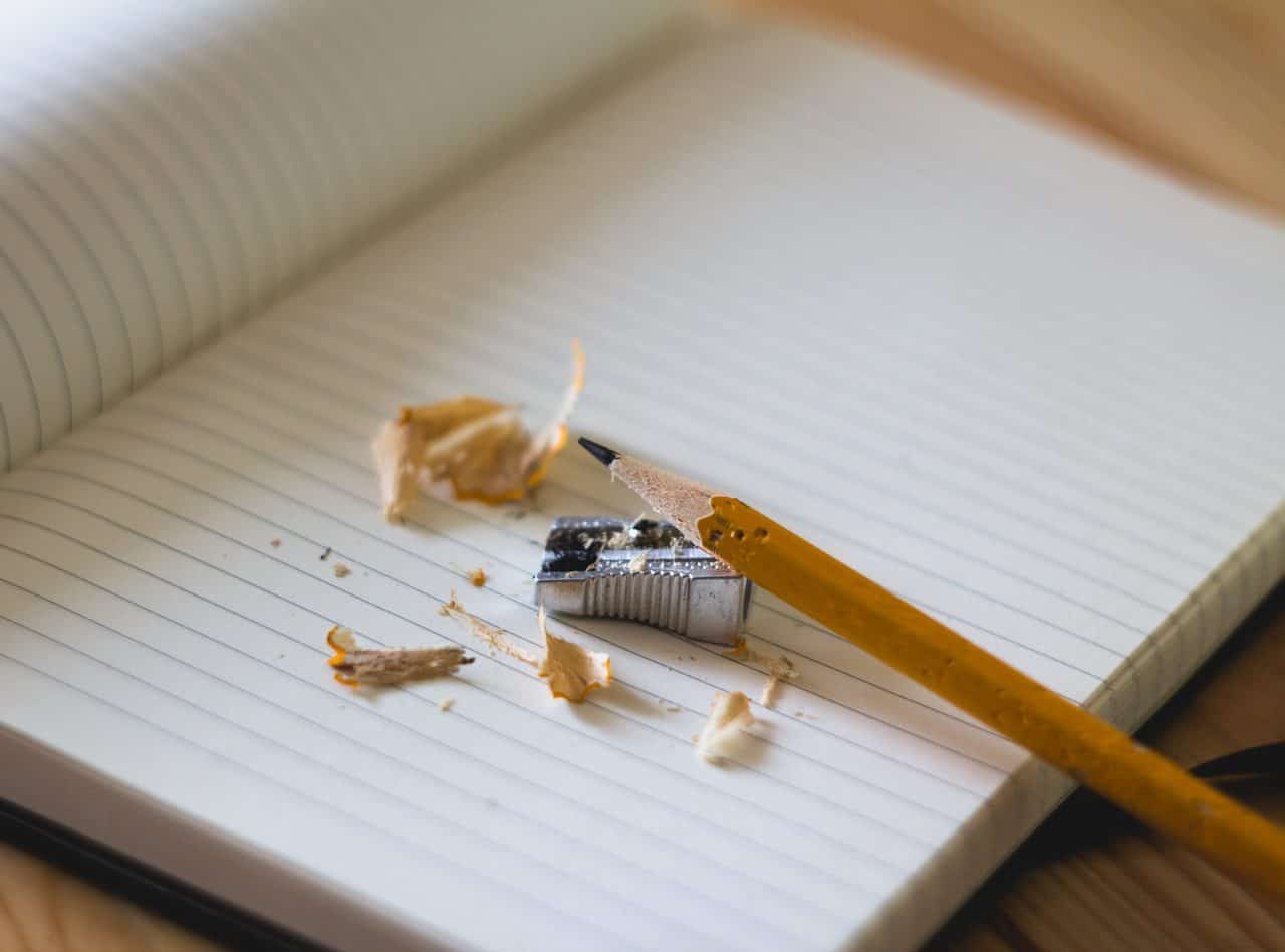 Helotes Schools feature image with Open notebook with a pencil and sharpener with shavings on a desk top