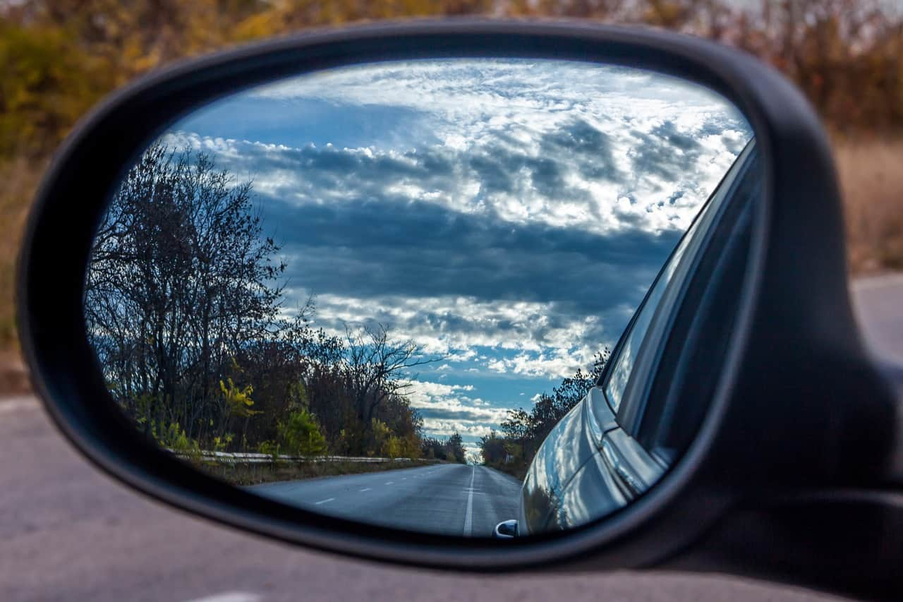 road and skyline in the rear view mirror
