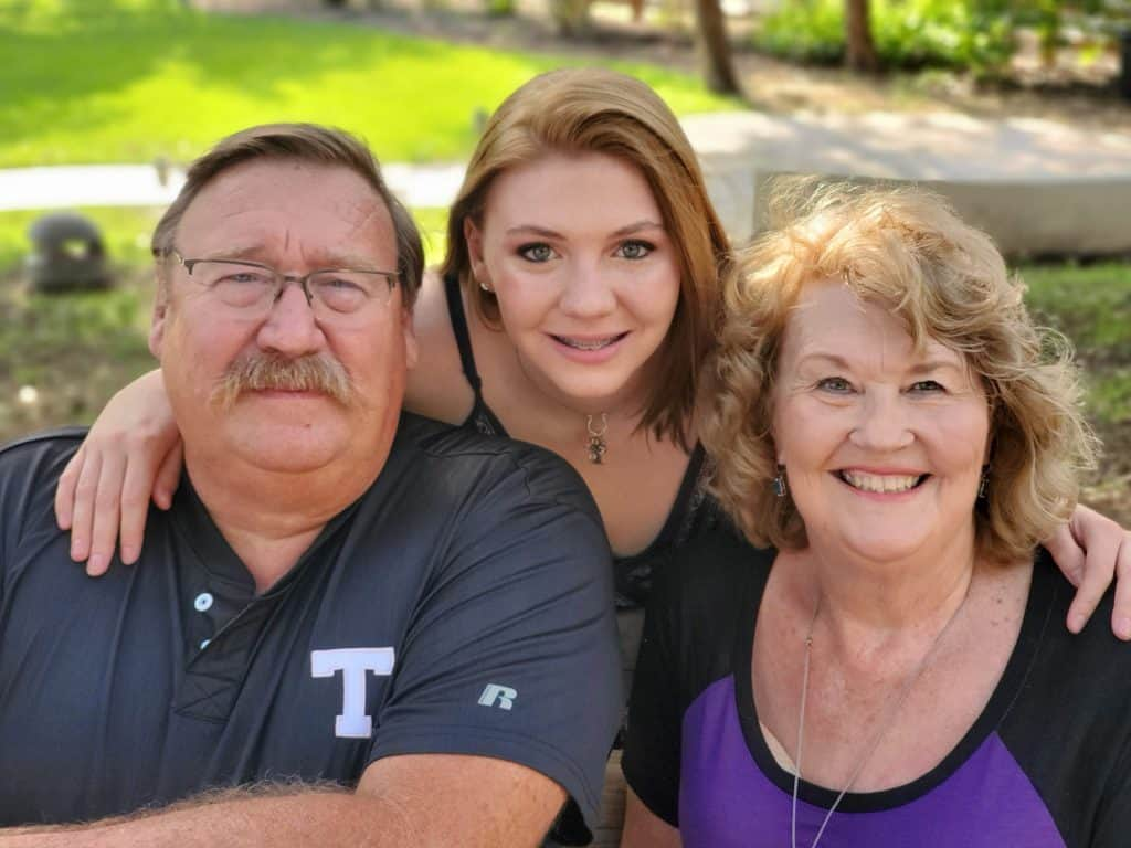 Teen and two grandparentsoutside for Senior pictures