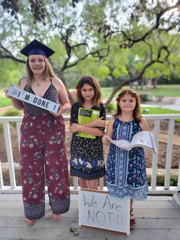 Teen and two sisters outside for Senior pictures