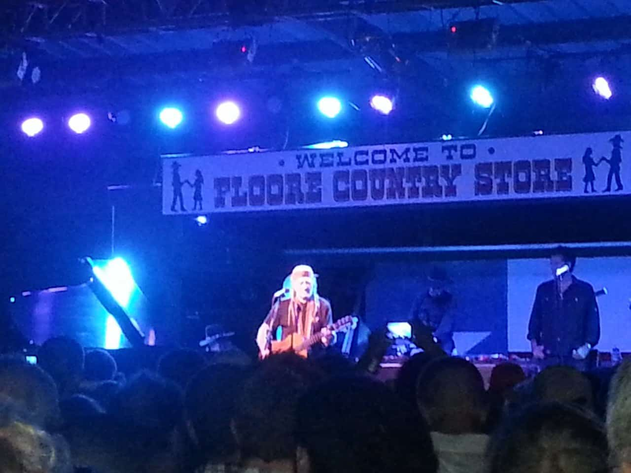 Exterior of Floores Country Store stage with Willie Nelson