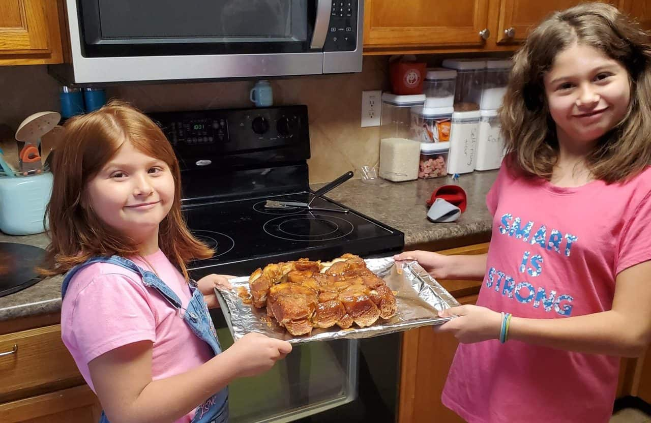 two monkeys holding some homemade monkey bread between them
