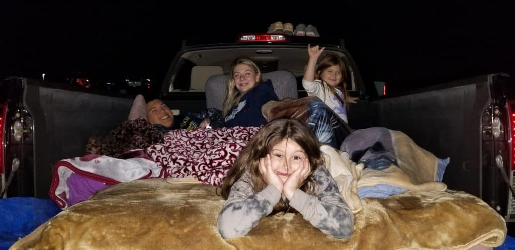 kids in the back of the truck at the drive-in