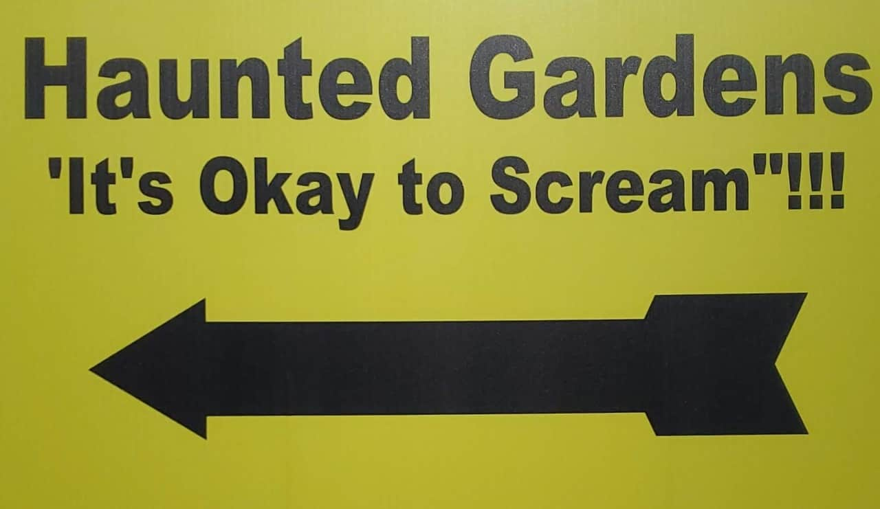 yellow sign for haunted gardens